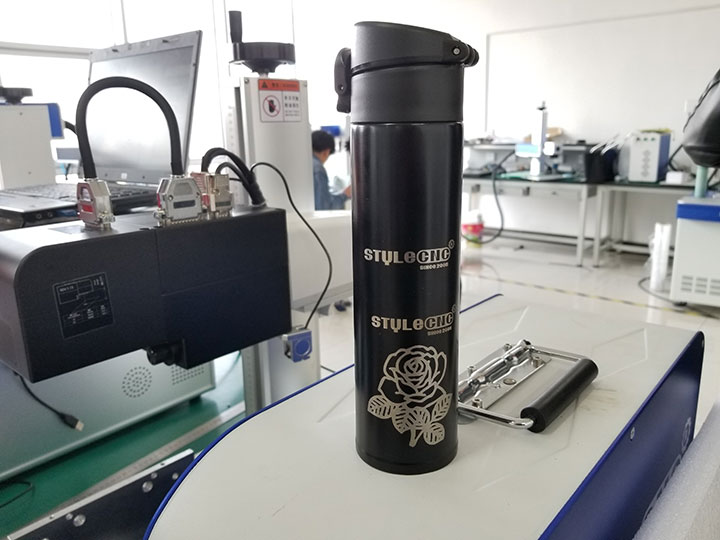 Powder coated cup laser engraving with rotary attachment