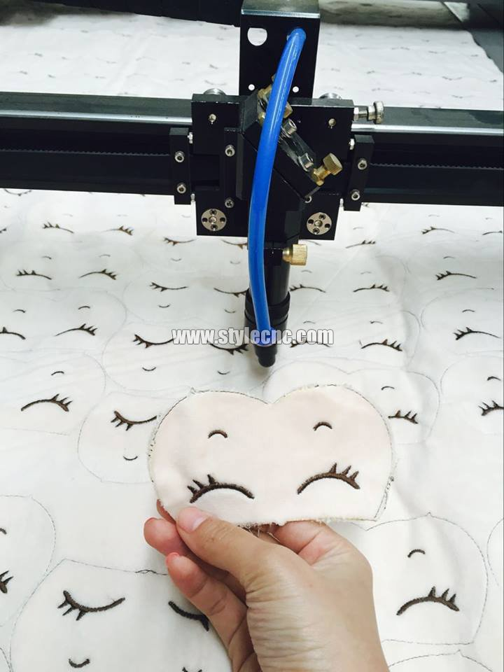 Laser fabric cutter processing