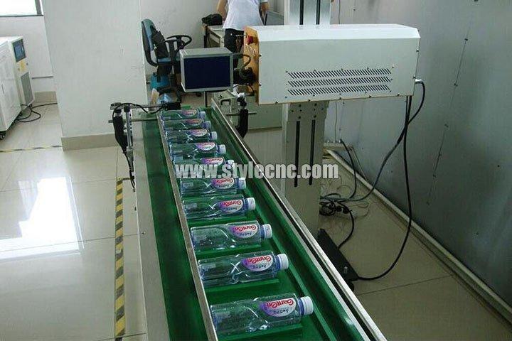 Online flying laser marking machine processing