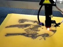 Laser <i><i>engraving</i></i> machine working on sandblasting <i><i>marble</i></i>