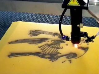 Laser engraving machine working on sandblasting marble