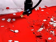 Laser <i><i>paper</i></i> <i><i>cutting</i></i> <i><i>machine</i></i> working on wedding invitation card