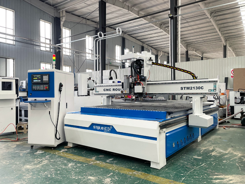 The First Picture of Intelligent 3 heads CNC router machine with auto nesting system