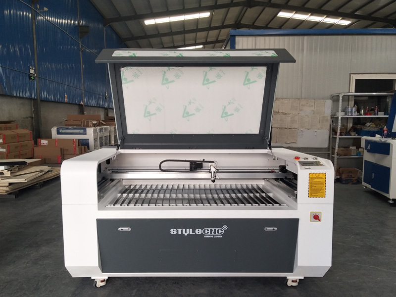 New design STJ1390 CNC laser engraving and cutting machine delivery to Pakistan