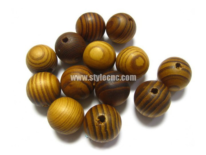 Small wood lathe turning wooden beads