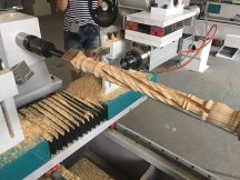 CNC wood lathe for stair handrail hollowing