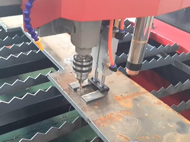 CNC plasma cutting table with drilling head combined