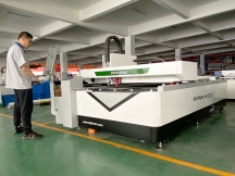 A Combined Fiber Laser and CO2 Laser Cutting System for Metal and Nonmetal